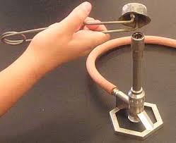 A metal striker can also be used to light a Bunsen burner.