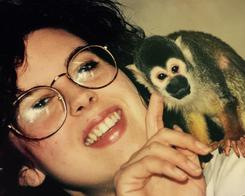 "Tami Port, MS with ""Captain"" the Squirrel Monkey in Graduate School at Bucknell"
