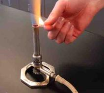 Lighting Bunsen Burner with Match